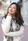 Winter: Asian Girl in white coat outdoors, street Royalty Free Stock Photo