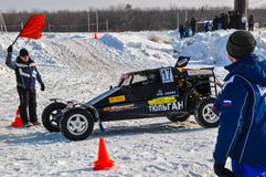 Winter auto racing on makeshift machines. Stock Photos