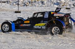 Winter auto racing on makeshift machines. Royalty Free Stock Image