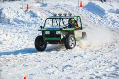 Winter auto racing on makeshift machines. Stock Photo