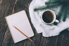 Winter and autumn composition. Top view of vintage notebook with fir tree and pencil, decorated with cup of coffee Stock Photo