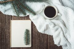 Winter and autumn composition. Top view of vintage notebook with fir tree and pencil, decorated with cup of coffee Stock Images