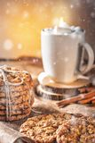 Winter autumn still life  homemade recipe honey ginger oatmeal cookie and bagel, cocoa cup coffee with marshmallow o. N wooden table kitchen Jute, burlap Rustic Royalty Free Stock Photo
