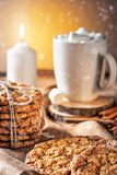 Winter autumn still life  homemade recipe honey ginger oatmeal cookie and bagel, cocoa cup coffee with marshmallow o. N wooden table kitchen Jute, burlap Rustic Royalty Free Stock Images