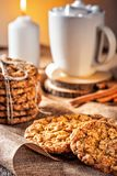 Winter autumn still life  homemade recipe honey ginger oatmeal cookie and bagel, cocoa cup coffee with marshmallow on wooden table. Kitchen Jute, burlap Rustic Stock Photo