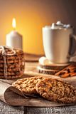 Winter autumn still life  homemade recipe honey ginger oatmeal cookie and bagel, cocoa cup coffee with marshmallow on wooden table. Kitchen Jute, burlap Rustic Royalty Free Stock Photography