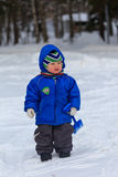 Winter baby. Walking in snow Stock Photos