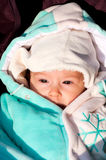 Winter baby. Portrait of thinking baby in winter outdoors Royalty Free Stock Image