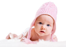 Winter Baby. Portrait of three months old baby girl wearing pink winter hat Royalty Free Stock Image