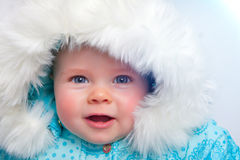 Winter baby. Cute little baby in a warm jacket Stock Photography