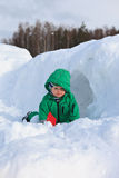 Winter baby joy. 1.5 year old boy having fun in snow Royalty Free Stock Photo