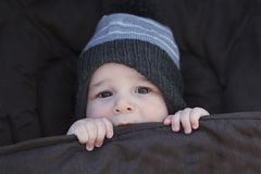 Winter baby keeping warm Stock Photos