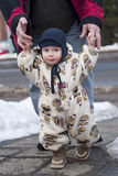 Winter baby walking Royalty Free Stock Images