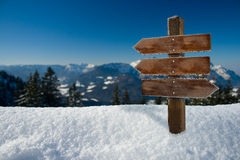 Winter backdrop. Panorama of the alps with a wooden sign Stock Photography