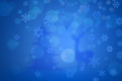 Winter background. Blue background with snowflakes, raindeer and spruce Stock Images