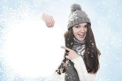 Winter background. Young woman holding blanc white board Stock Photography