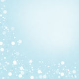 Winter background. Snowflakes over light blue texture Royalty Free Stock Photo