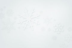 Winter background. White winter background with snowflakes paper cut-out Royalty Free Stock Images