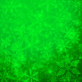 Winter background. Green winter background with a lot of snowflakes stock illustration