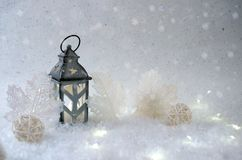 Winter background. Beautiful candlestick in the shape of a house. In a snow fairy forest Stock Photos