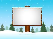 Winter background with blank sign in the snow Royalty Free Stock Image