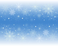 Winter background. In blue with snowflakes Stock Photos