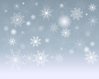 Winter background. Blue winter background with snowflakes Royalty Free Stock Photos