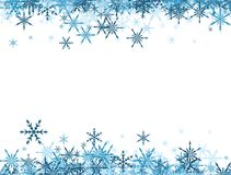 Winter background with blue snowflakes. Stock Images
