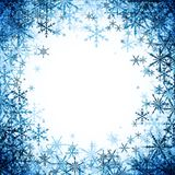 Winter background with blue snowflakes. Royalty Free Stock Photo