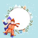 Winter background with children riding sleigh. Boy and girl  ride in a sleigh, winter background with snow, tres, mountains and houses Stock Photography