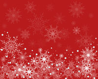 Winter background. Christmas background in red with snowflakes Royalty Free Stock Images