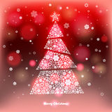 Winter background with Christmas tree made of snowflakes. Royalty Free Stock Photo