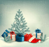 Winter background of christmas tree with presents Royalty Free Stock Image
