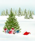 Winter background with a christmas tree, presents Stock Image