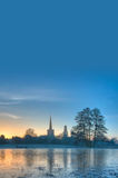 Winter background with church at sunrise Royalty Free Stock Image
