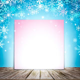 Winter background with decorative sparkling snowflakes and empty piece of paper for your text. Stock Images