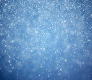 The winter background, falling snowflakes stock photography