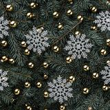 Winter background of fir branches. Adorned with gold baubles. Snowflakes silver. Christmas card. Top view. Xmas congratulations royalty free stock photography