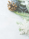 Winter background with fir tree branches and pine cone. Christmas winter gray background with fir tree branches, pine cones, baubles and snow. New year greeting Stock Images