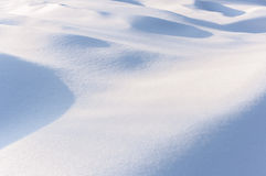 Winter background. Fresh sunlit snow. Royalty Free Stock Image