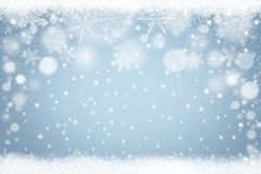Winter background with frozen snowflakes and falling snow Royalty Free Stock Photography
