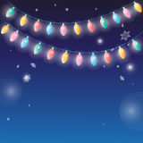 Winter background with garlands lamps Stock Photos