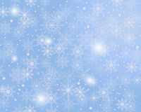 Winter background. Gentle winter blue background of snowflakes Royalty Free Stock Images