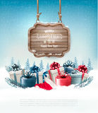 Winter background with gift boxes and a wooden ornate Royalty Free Stock Photography