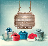 Winter background with gift boxes and a wooden ornate Stock Photography