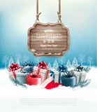 Winter background with gift boxes and a wooden ornate Royalty Free Stock Photo