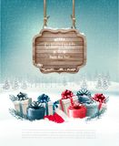 Winter background with gift boxes and a wooden ornate. Merry christmas sign. Vector Stock Images