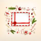 Winter background with gift. Top view of festive design elements. Winter background with gift boxes and decorations. Flat lay Christmas composition with fir tree Stock Photography