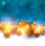 Winter background with golden christmas balls. Royalty Free Stock Images