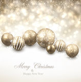 Winter background with golden christmas balls. Royalty Free Stock Image